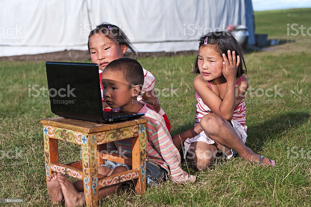 Mongolian children using laptop stock photo