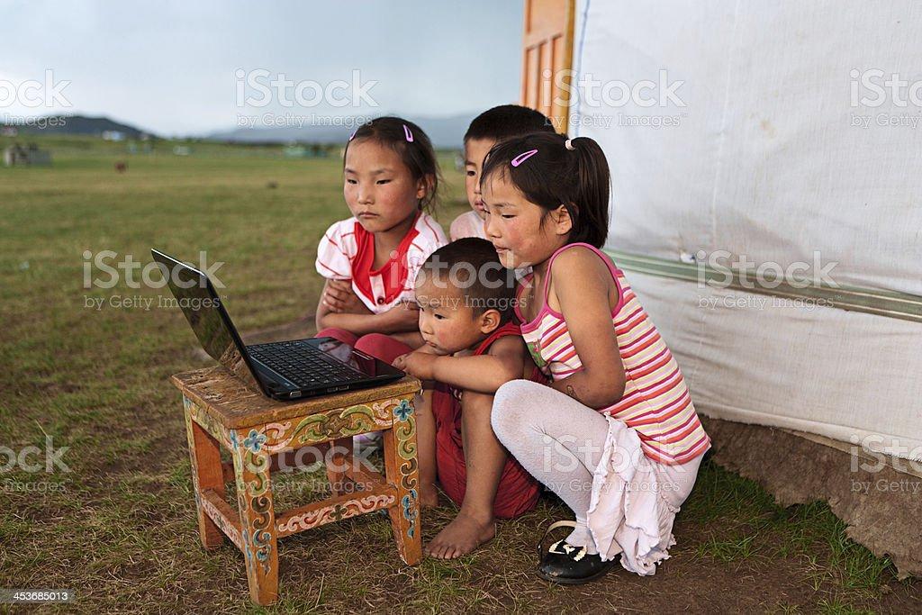 Mongolian children using laptop royalty-free stock photo