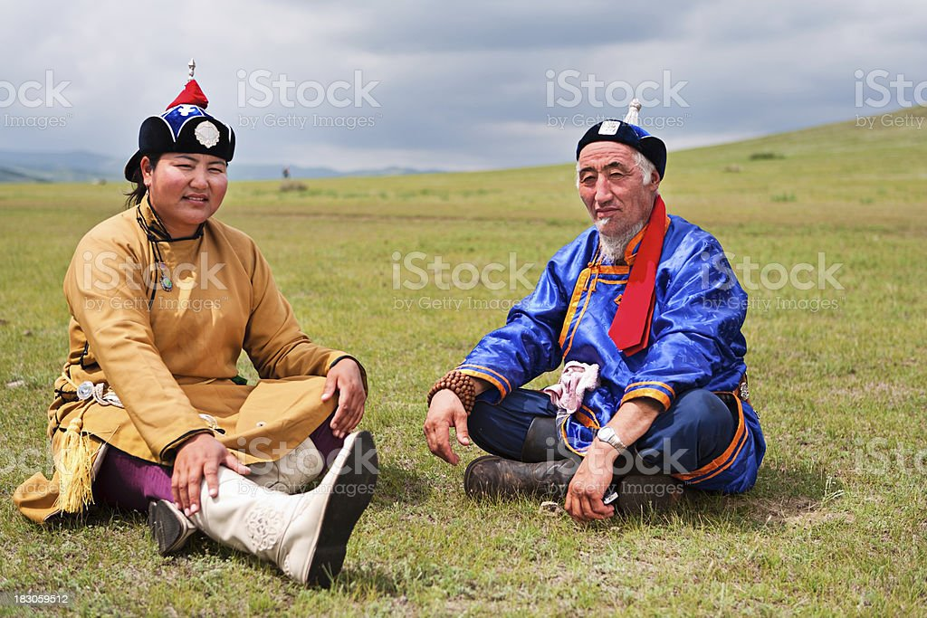 Mongolian couple in national clothing during Naadam Festival. stock photo