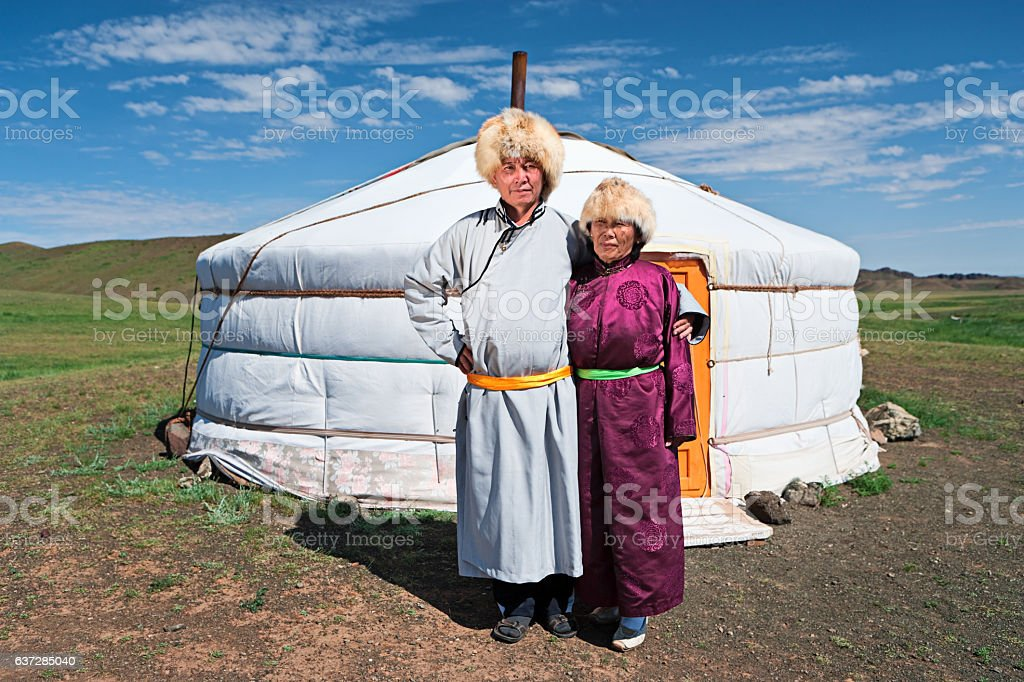 Mongolian couple in national clothing next to ger stock photo