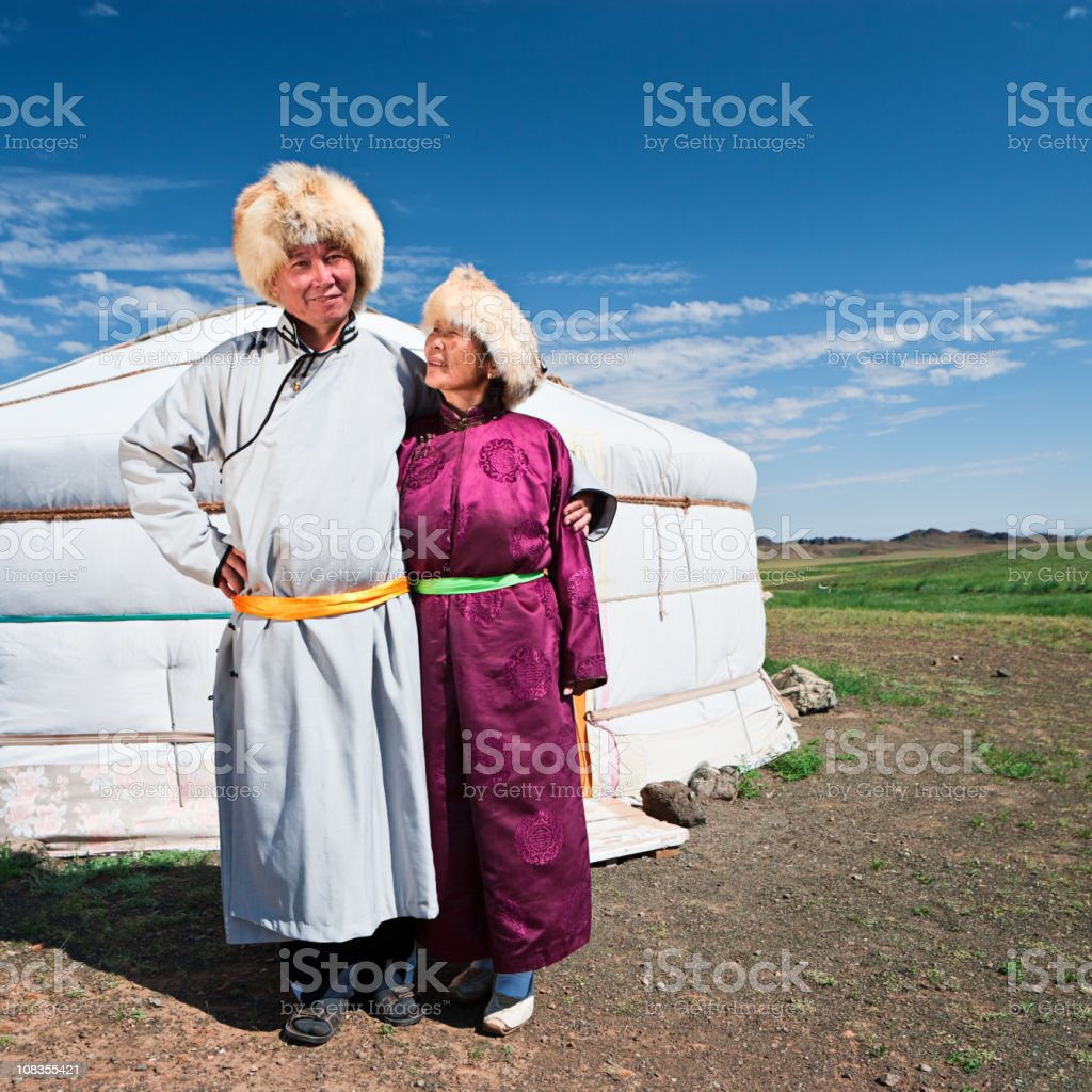 Mongolian couple in national clothing royalty-free stock photo