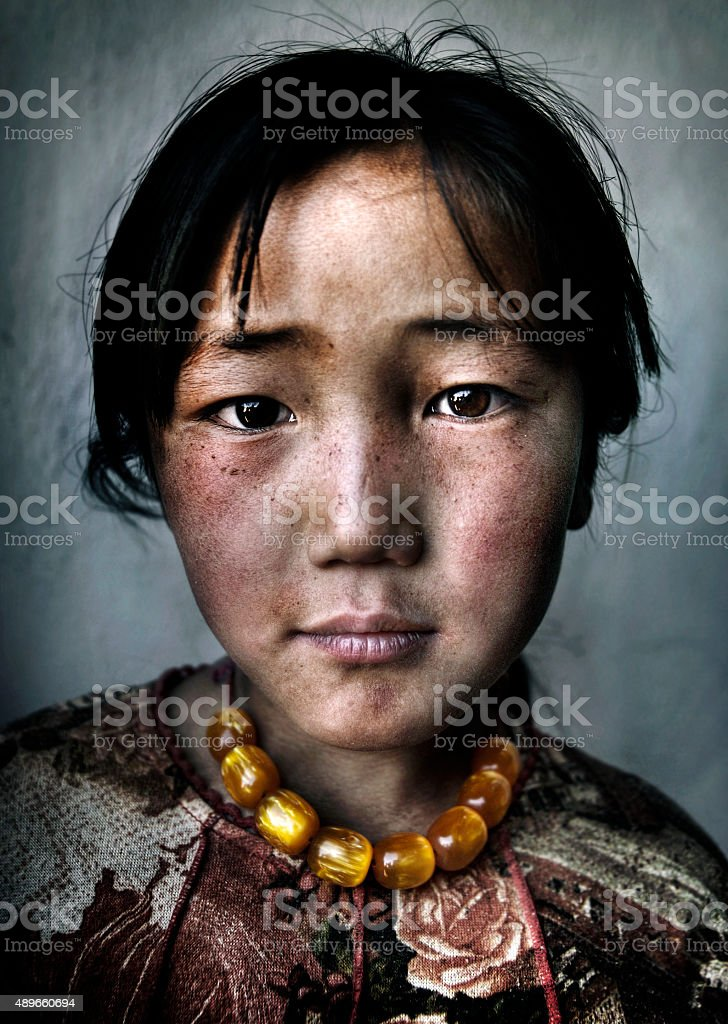 Mongolian Girl Portrait Innocent Culture Poverty Concept stock photo