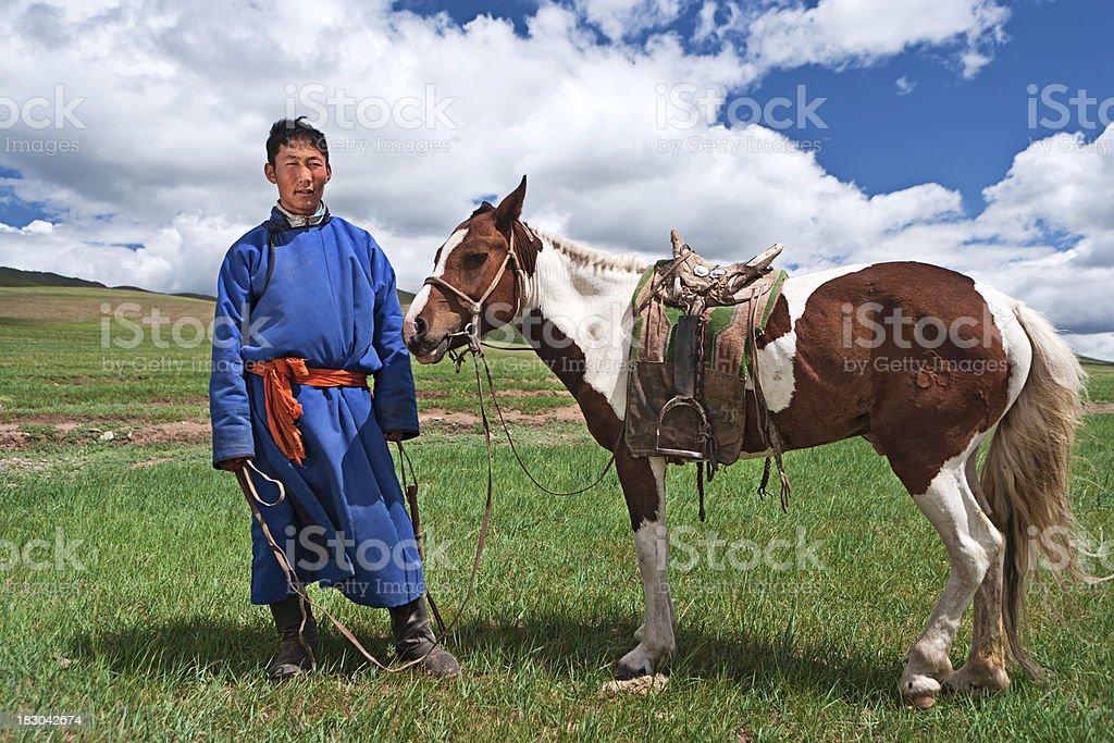 Mongolian horseback rider stock photo
