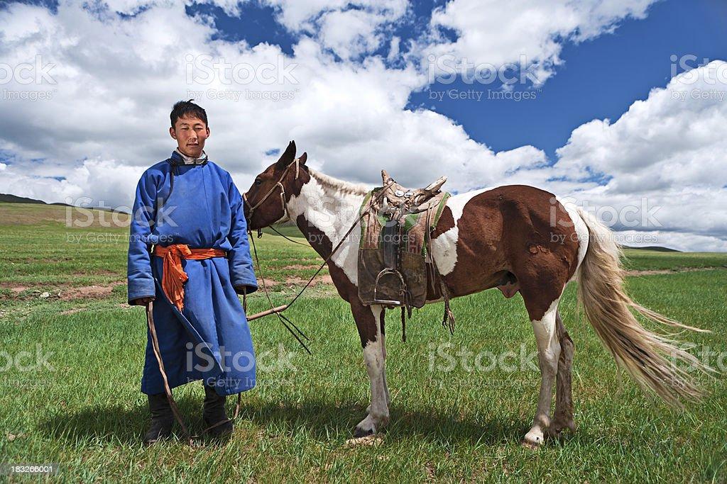 Mongolian horseback rider royalty-free stock photo