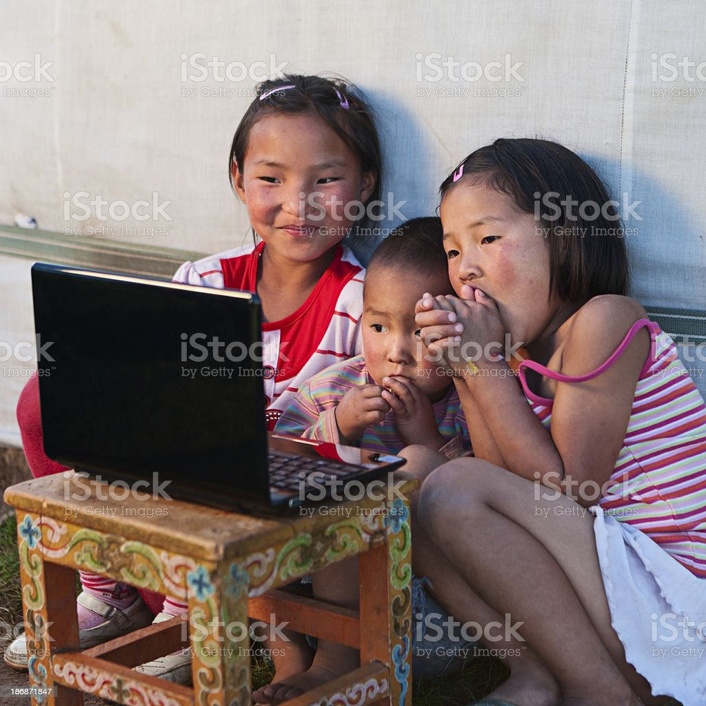 Mongolian kids with laptop royalty-free stock photo