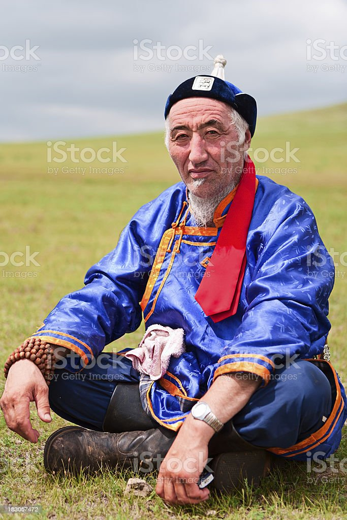 Mongolian man in national clothing during Naadam Festival. stock photo