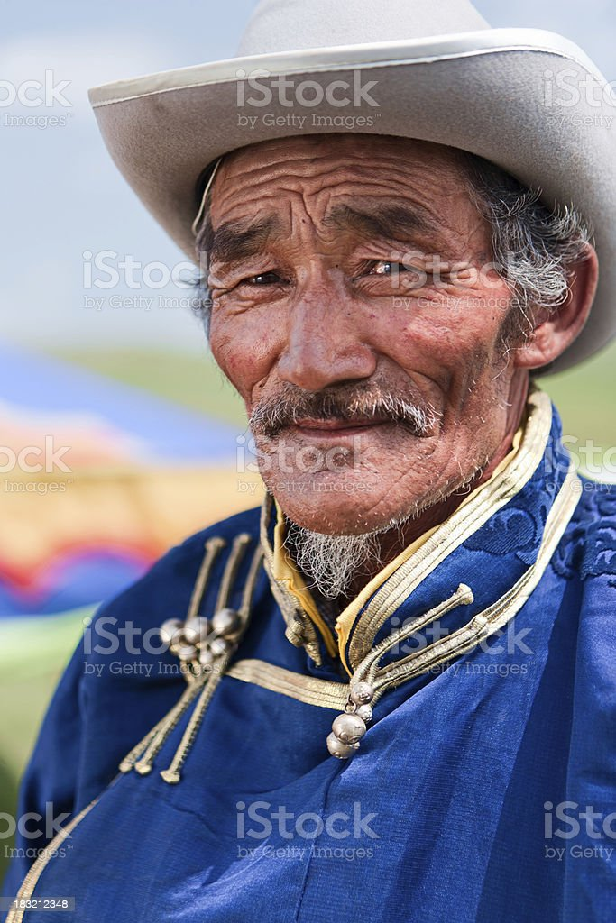 Mongolian man in national clothing during Naadam Festival stock photo