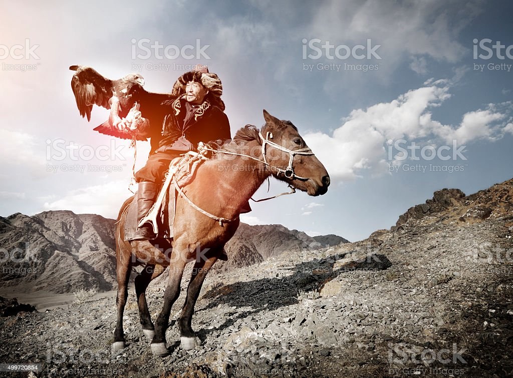 Mongolian Man Trained Eagle Kazakh Olgei Western Concept stock photo