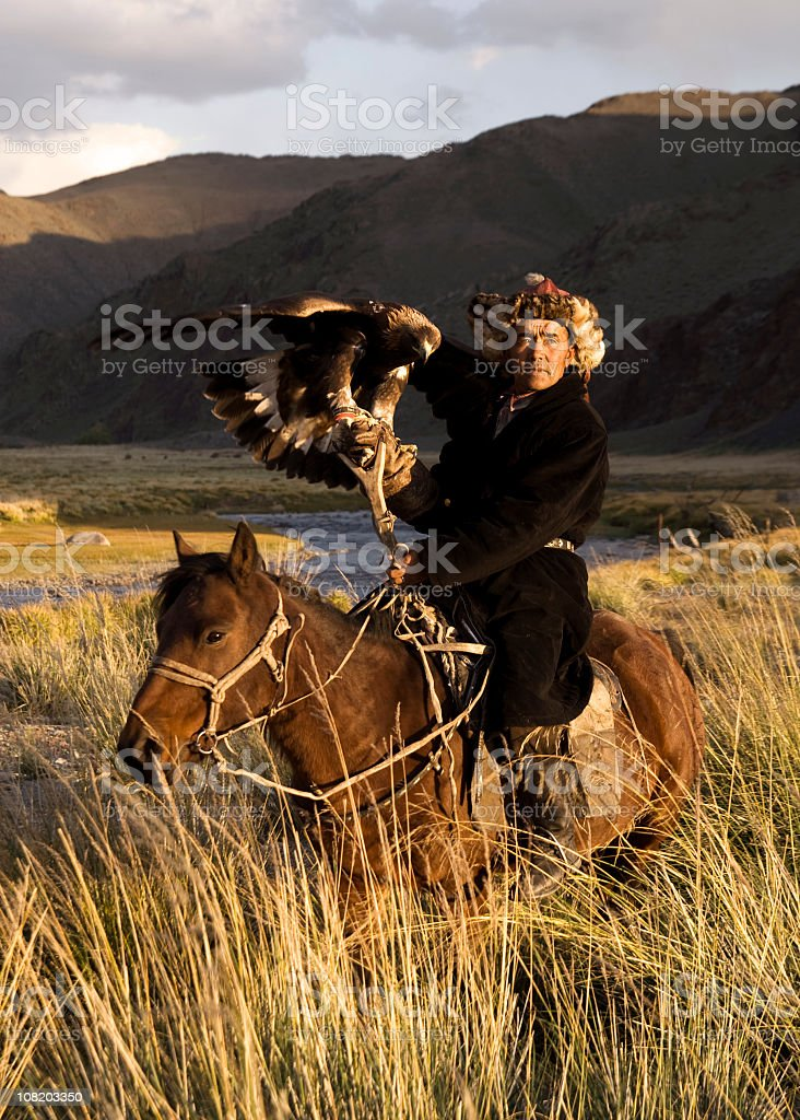 Mongolian Man with Trained Eagle royalty-free stock photo