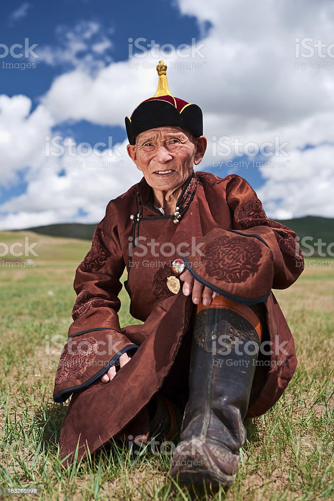 Mongolian old man in national clothing, medals on his chest royalty-free stock photo