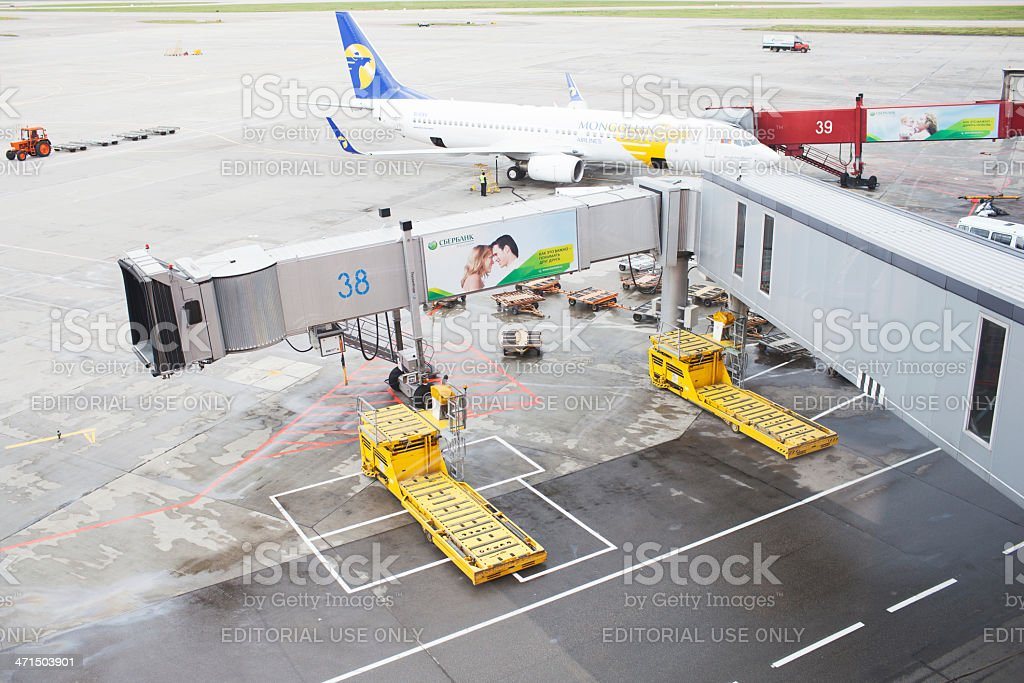 Mongolian plane waits patiently in Moscow's airport finger. royalty-free stock photo