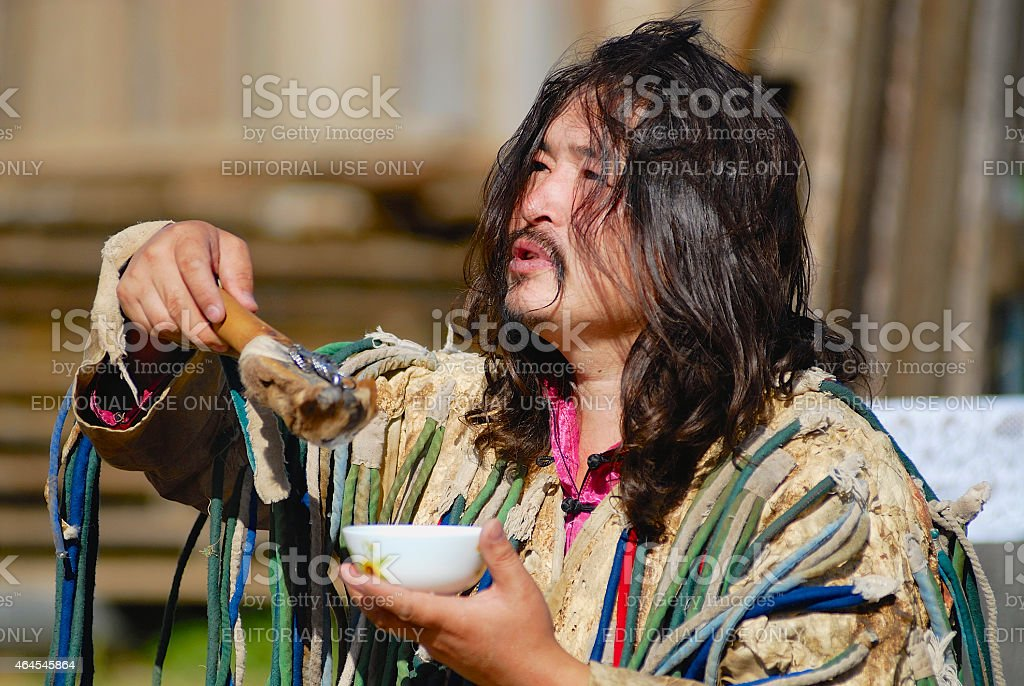 Mongolian shaman performs a ritual in Ulan Bator, Mongolia. stock photo