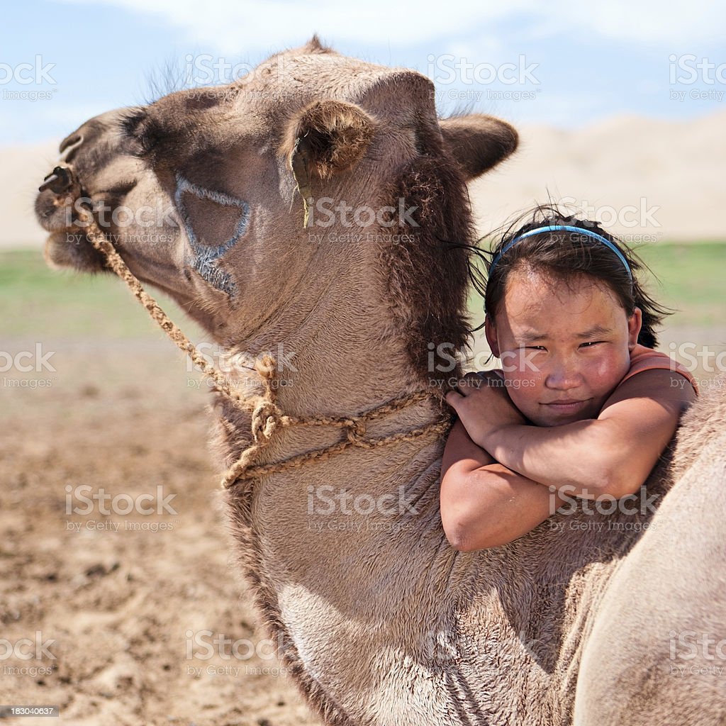 Mongolian young girl with camel royalty-free stock photo