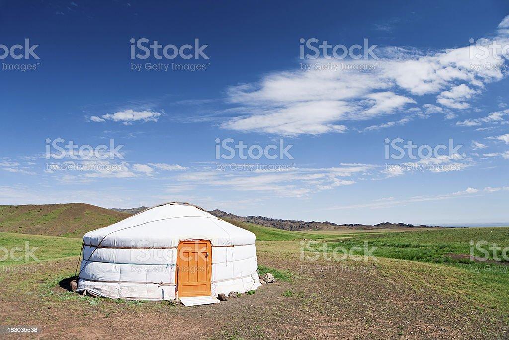 Mongolian yurt, hills in the background stock photo