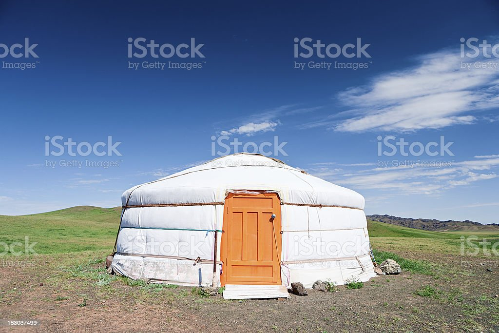 Mongolian yurt, hills in the background royalty-free stock photo