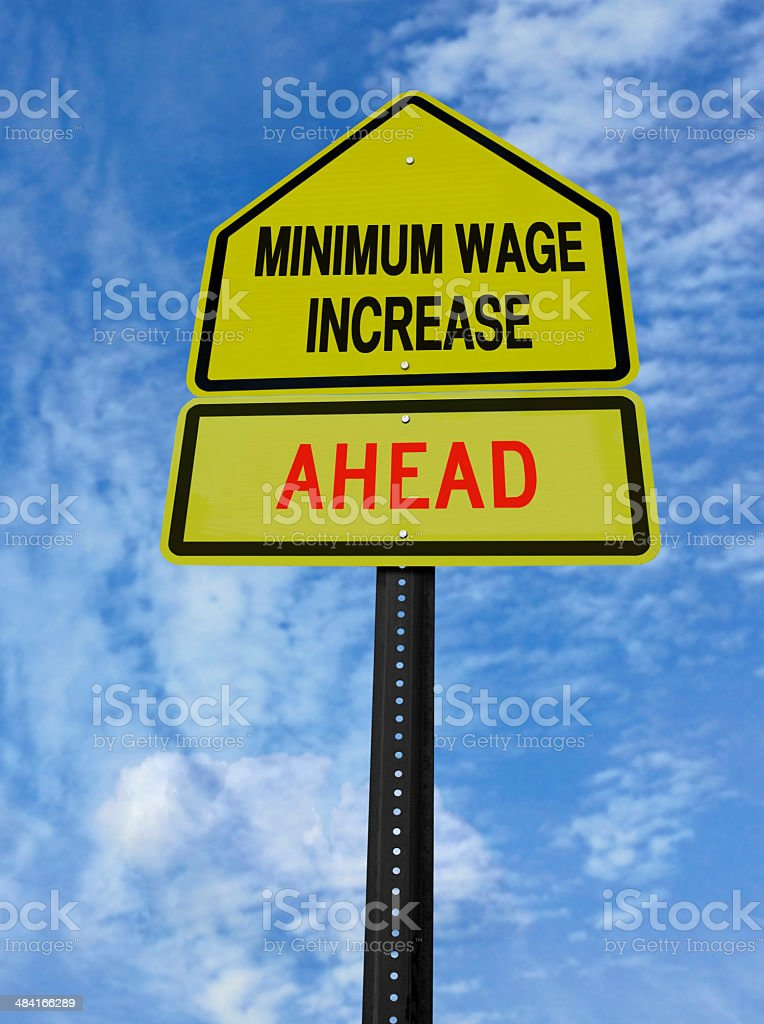monimum wage increase ahead stock photo