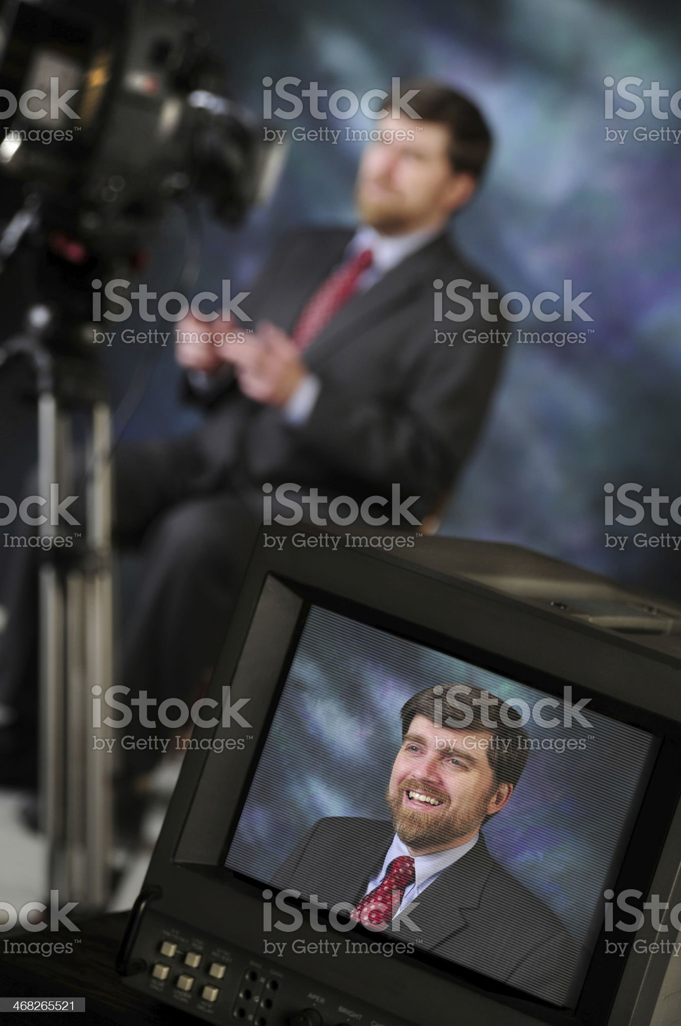 Monitor in studio showing man talking to video camera royalty-free stock photo