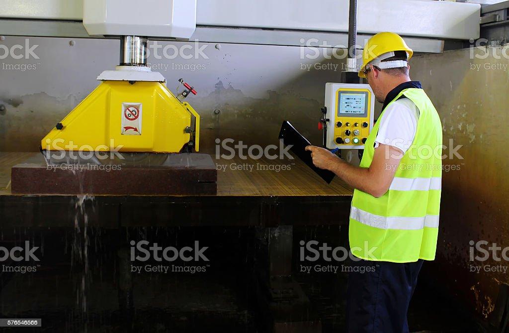 Monitor machine cut marble stone stock photo