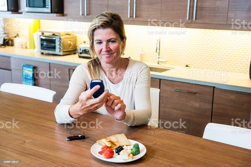 Monitoring blood sugar for diabetes stock photo