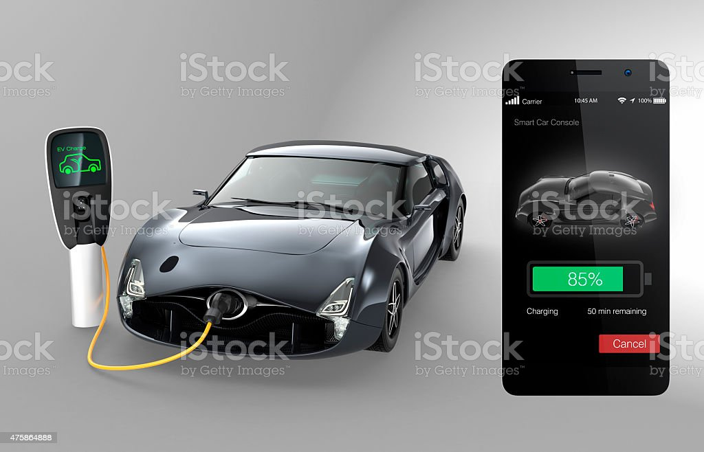 Monitoring electric car charging state by smart phone app stock photo