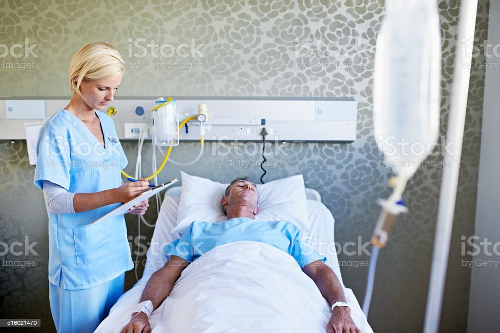 Monitoring her patient's progress stock photo