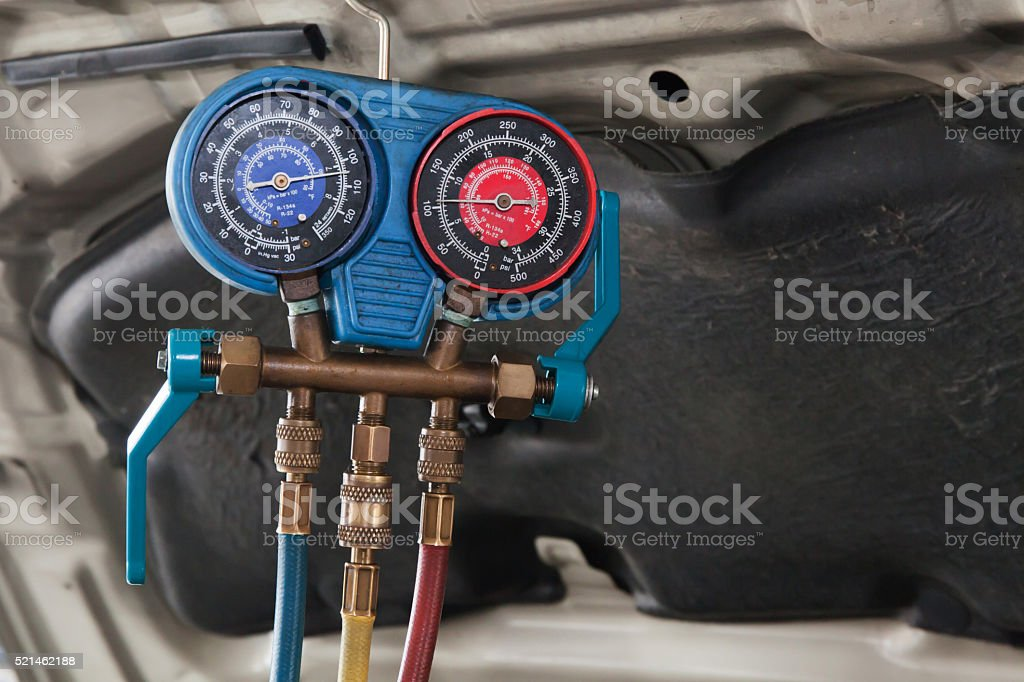 Monitoring tools for automotive air conditioning in car garage stock photo