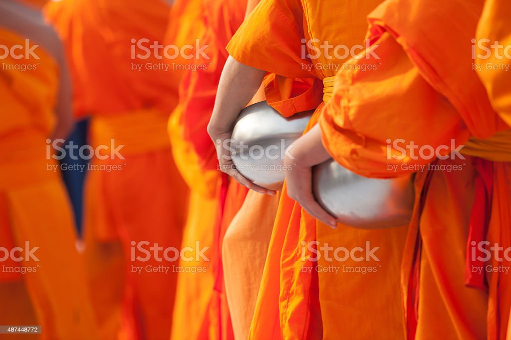 monk alms bowl stock photo