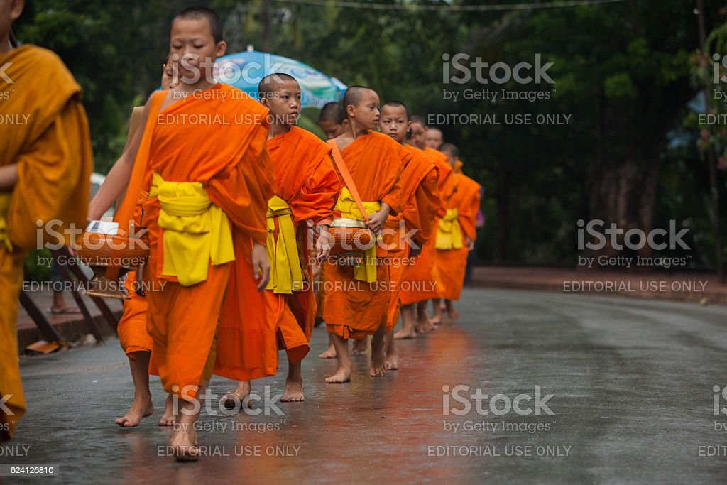 Monk Alms Giving Procession in Luang Prabang stock photo