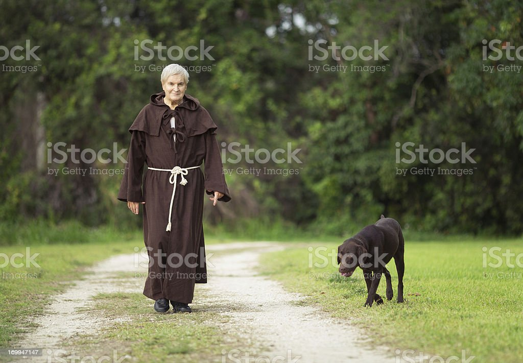 monk and his dog stock photo
