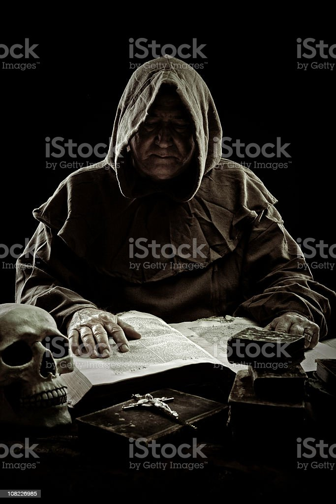 monk and homework stock photo