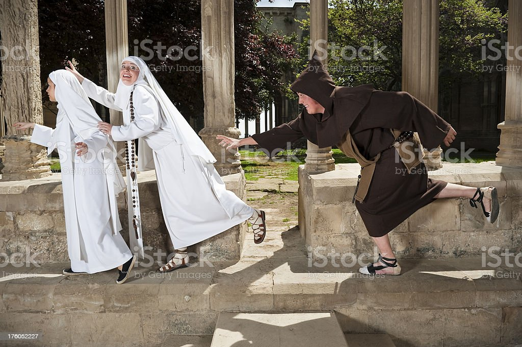 Monk and nuns playing royalty-free stock photo