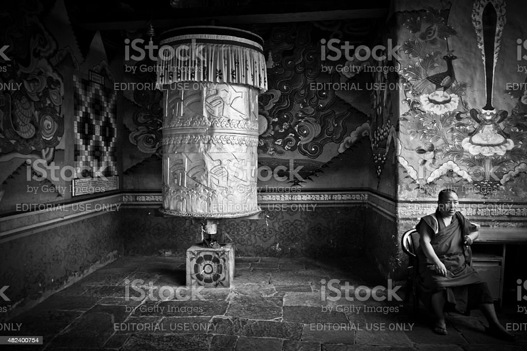Monk and prayer wheel of Punakha Fortress Monastery, Paro, Bhutan stock photo