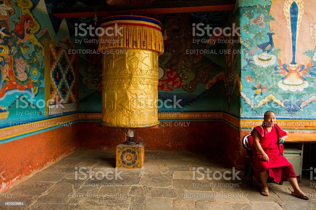 Monk and prayer wheel of Punakha Fortress Monastery, Paro, Bhutan stock photo