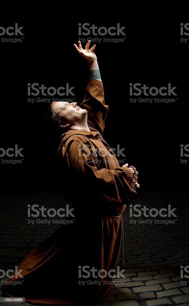 Monk asking God for help stock photo