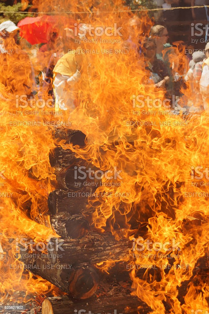 Monk behind the fire at Fire Walking Festival in Miyajima stock photo