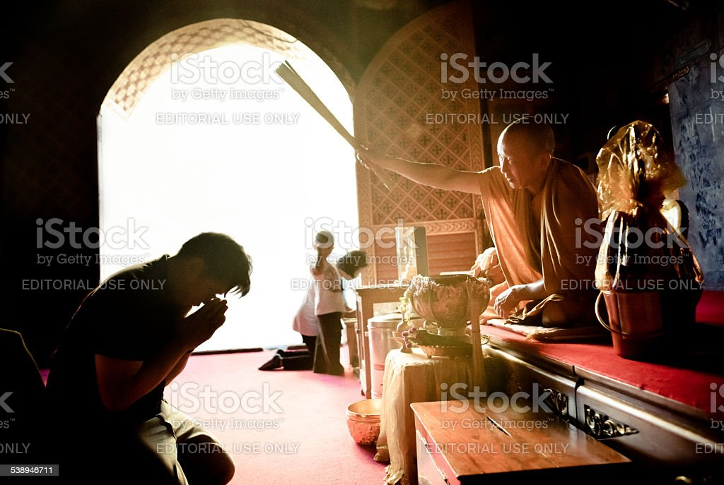 Monk blesses visitors to Wat Phratat Doi Suthep stock photo