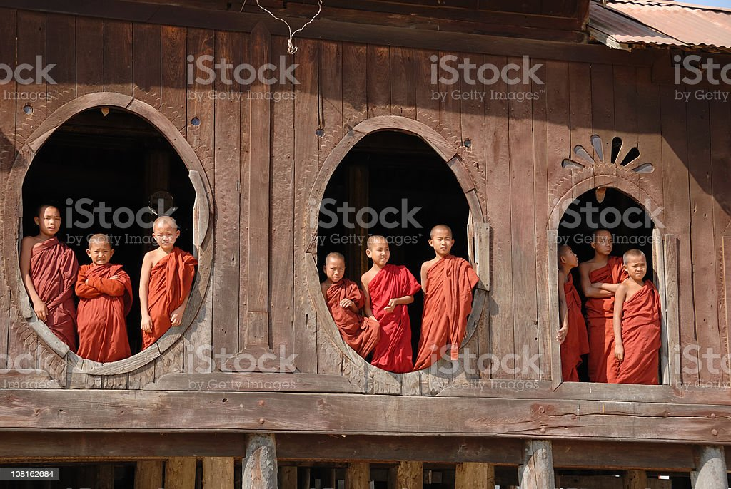 Monk class - novices looking out the window stock photo