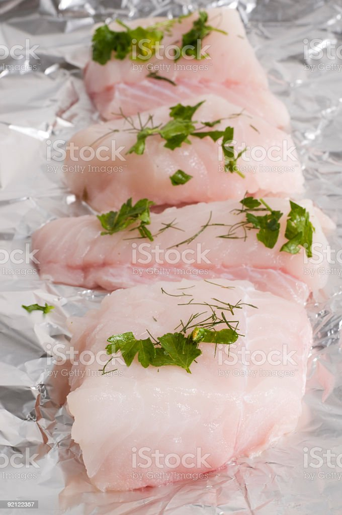 monk fish on foil with herbs royalty-free stock photo