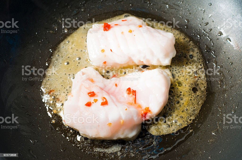 monk fish with chilies cooking in work royalty-free stock photo