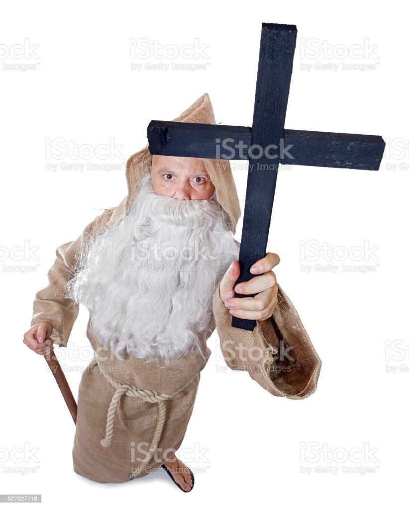 monk holding a crucifix stock photo
