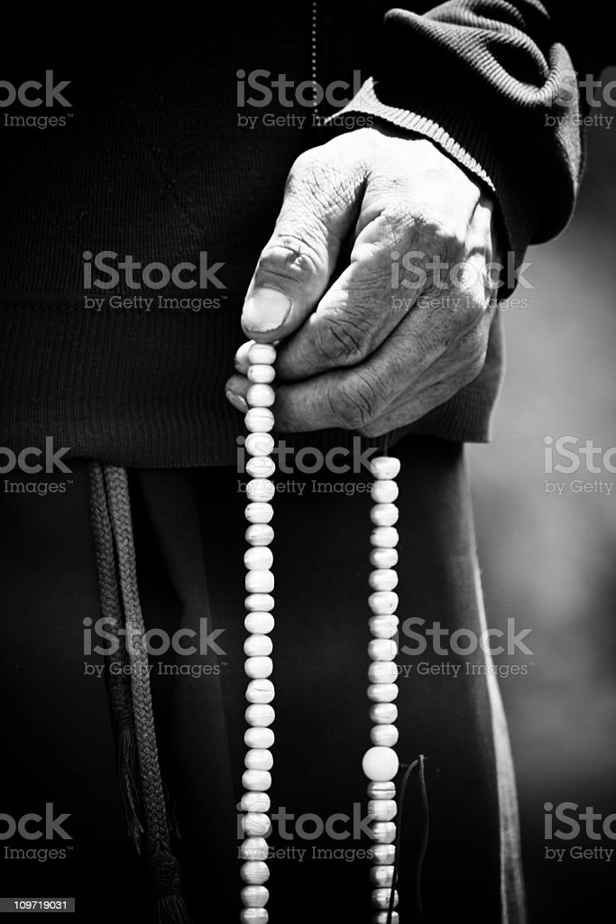 Monk Holding Prayer Beads, Black and White stock photo