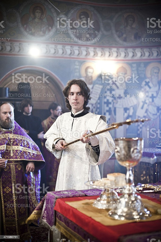monk holds fan under the chalice royalty-free stock photo
