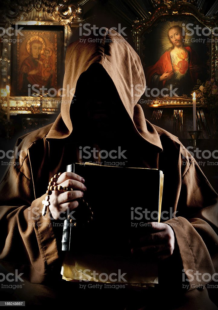 Monk in church stock photo