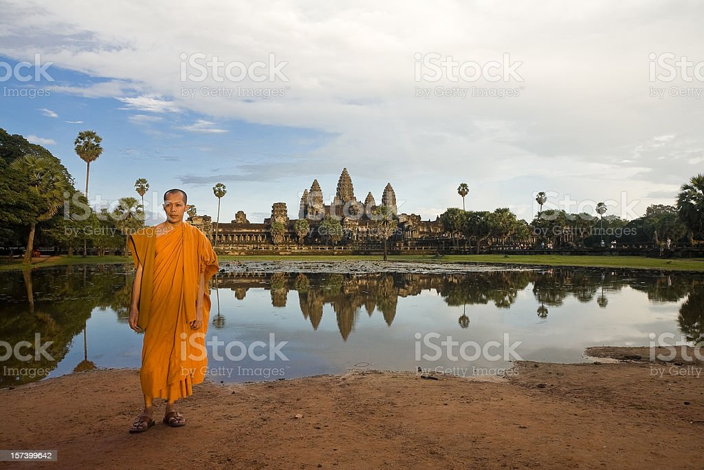 Monk in front of Angkor Wat royalty-free stock photo