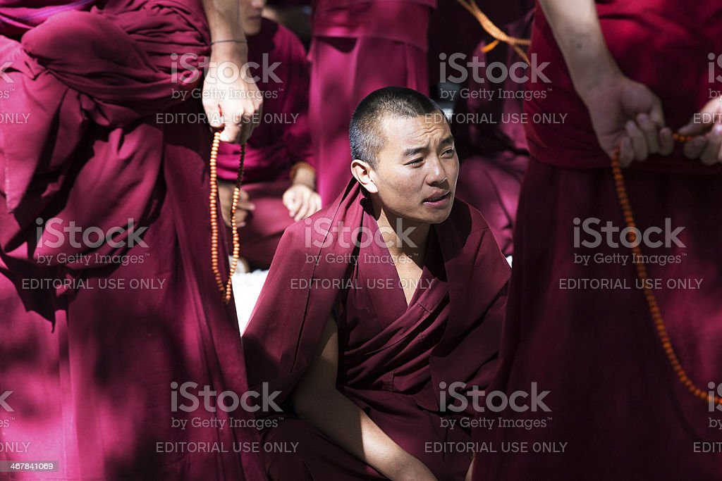Monk in Sutra Debate in Sera Monastery stock photo