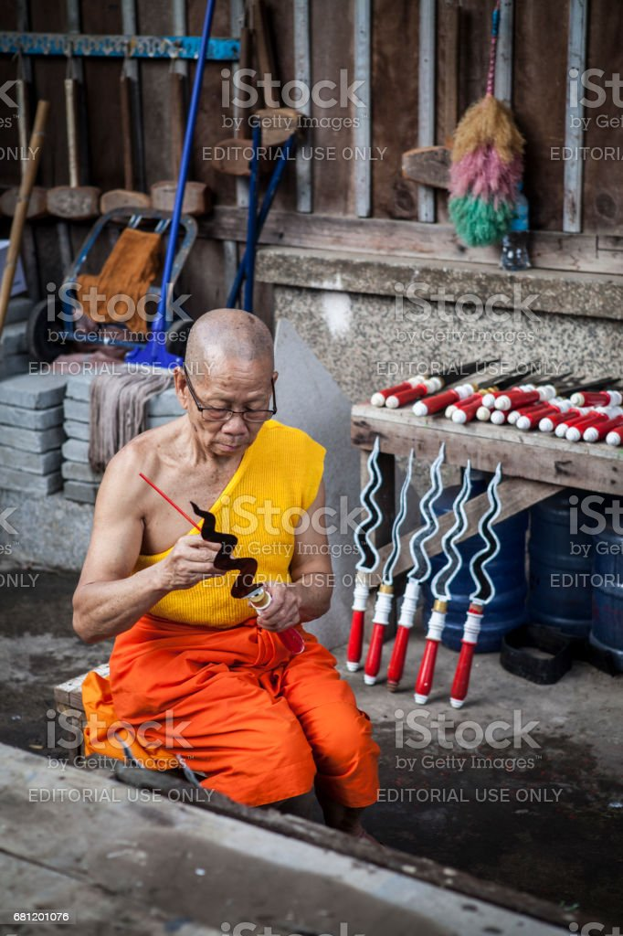 A Monk is getting ready for the ceremony stock photo