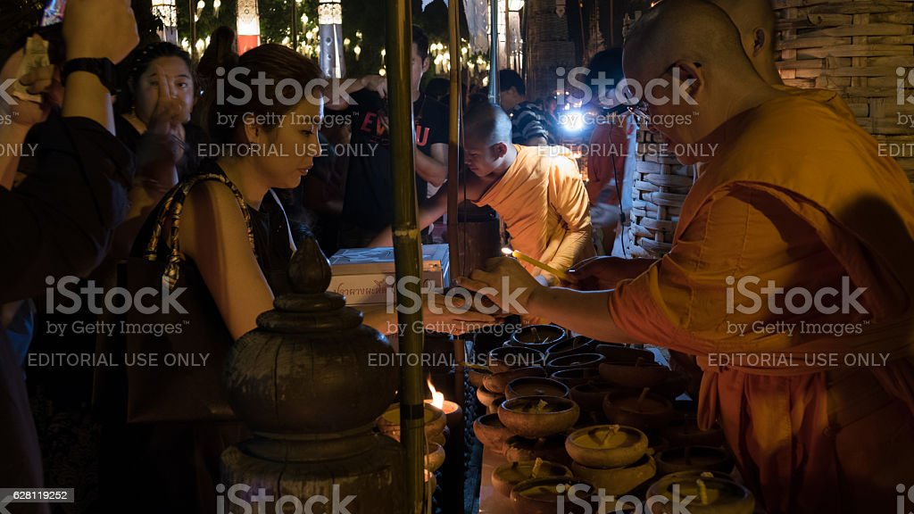 monk light candle for people in Loy Krathong festival stock photo