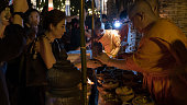 monk light candle for people in Loy Krathong festival