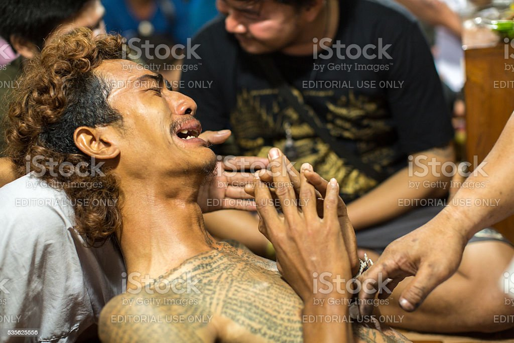 Monk makes traditional Yantra tattooing during Wai Kroo Master Day stock photo