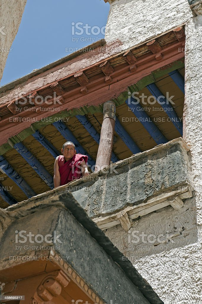 Monk on Balcony of Monastery India stock photo